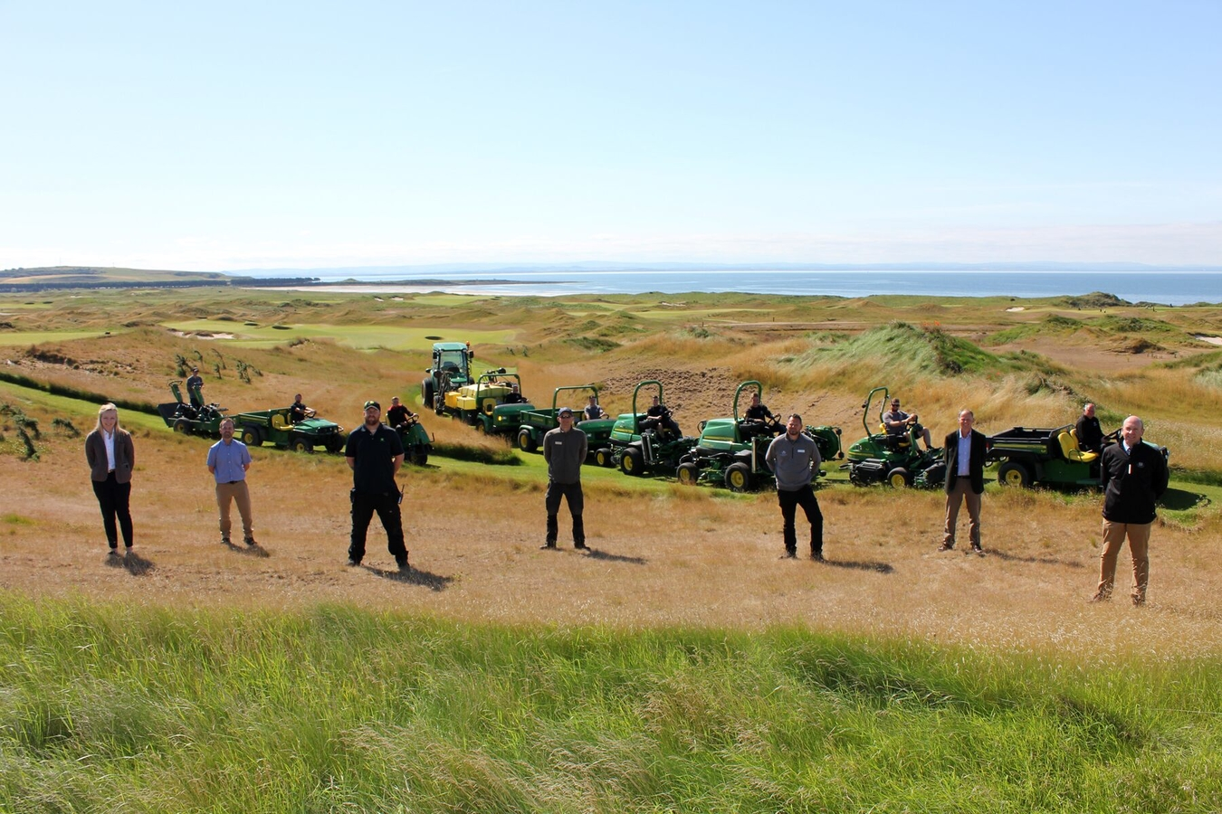 John Deere, Double A and Dumbarnie Links greenkeeping staff with some of the new John Deere machines on the links overlooking the Firth of Forth.