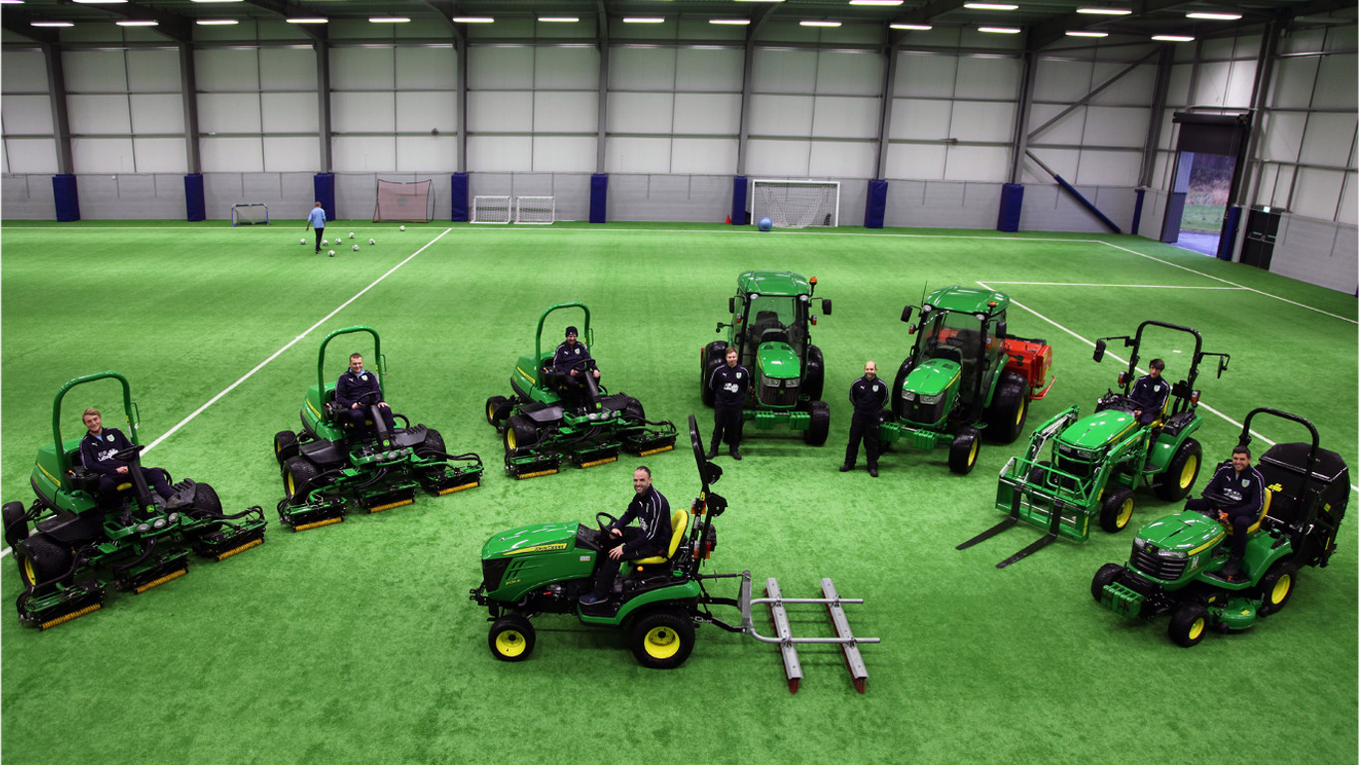 Burnley FC head groundsman Barry O'Brien (centre front) and his team with the new John Deere machinery fleet at the Barnfield Training Ground.