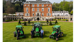 Lee Strutt and members of the greenkeeping team with the John Deere 4066R compacts and new 5125R utility tractor. Photo credit: Ash Youd Photography.