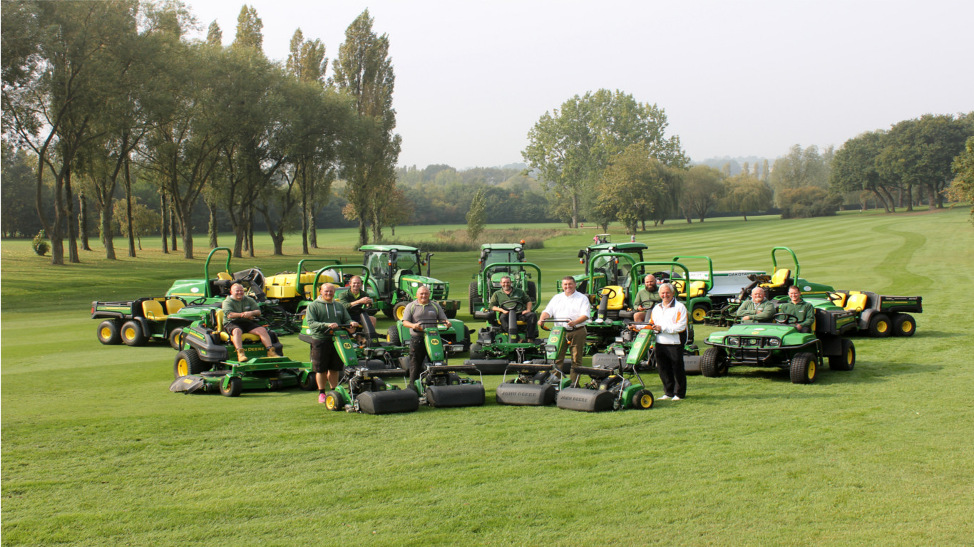 Abridge course manager Geoff Smith and chairman Lol Green with the greenkeeping team, Neil Peachey of dealer P Tuckwell Ltd and the new John Deere fleet.