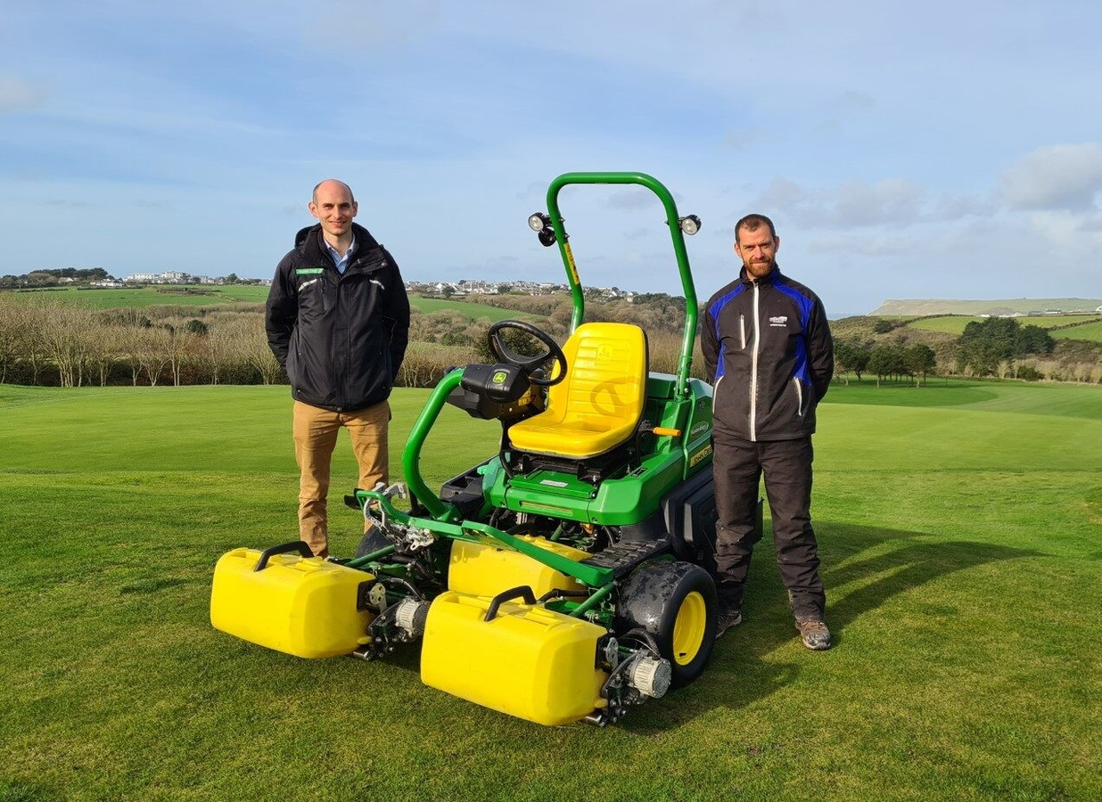 The Point at Polzeath's head greenkeeper Tom Collings (right) with dealer David Barnes of Masons Kings and the new John Deere 2750E hybrid mower.