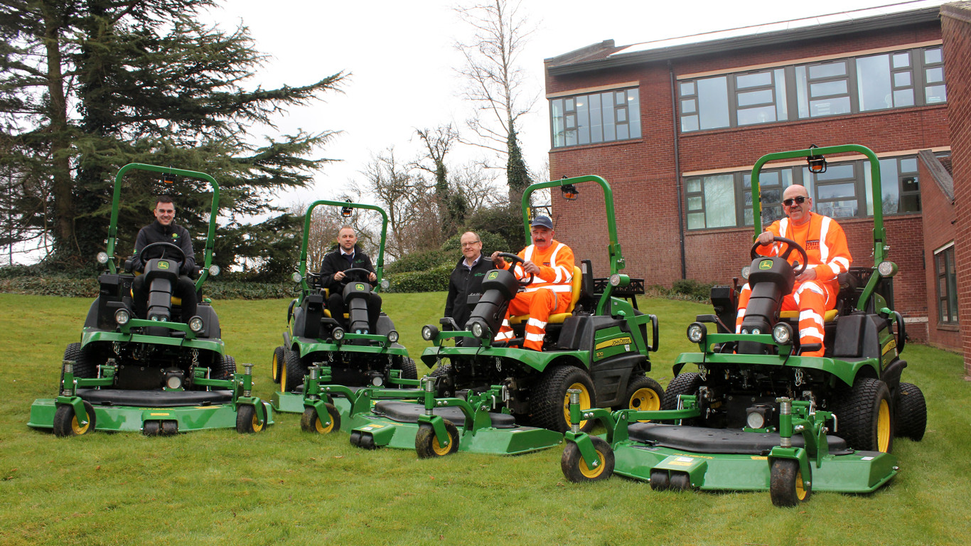 Chris Roe of Farol with Andrew Aston, Bob Taylor, operators Tony Boden and David Elsmore and the new John Deere mowers at South Staffordshire Council's HQ.