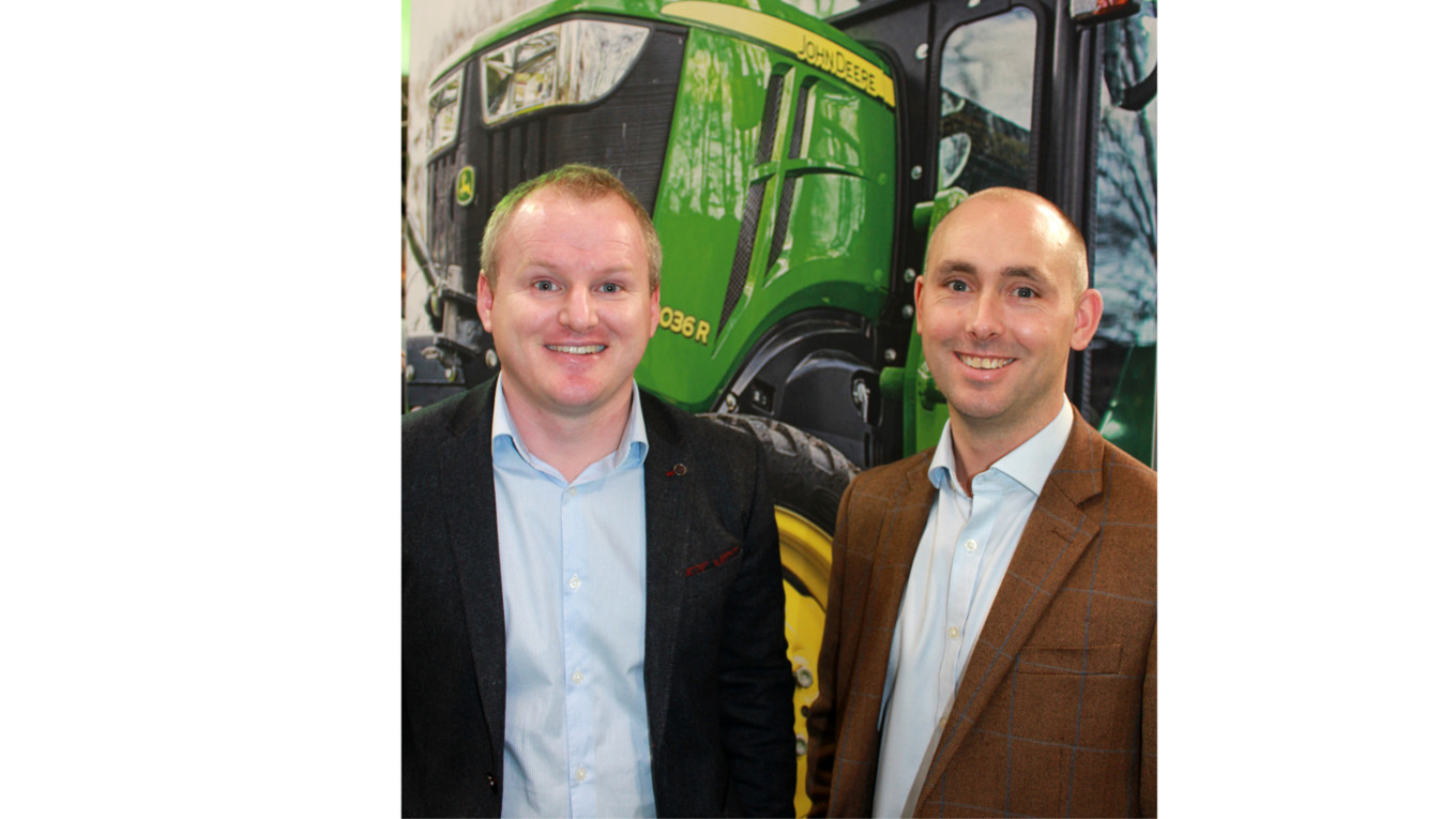 John Deere Limited's new strategic turf account manager Michael Grey (right) with Region 2's new product manager for compact & utility tractors Brian D'Arcy.