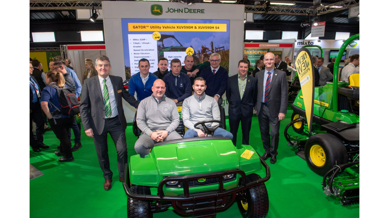 Chris Meacock of John Deere Ltd, GCSAI general manager Damian McLaverty & BIGGA CEO Jim Croxton (far left & right) with the 2019 volunteers at BTME.