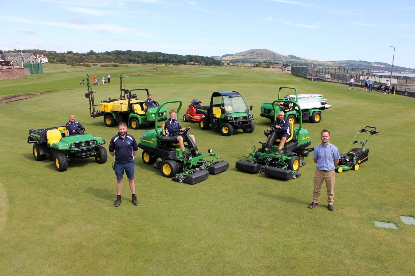 Leven Links course manager David Gray and Double A golf specialist John Bateson with the rest of the greenkeeping team and the new machinery fleet.