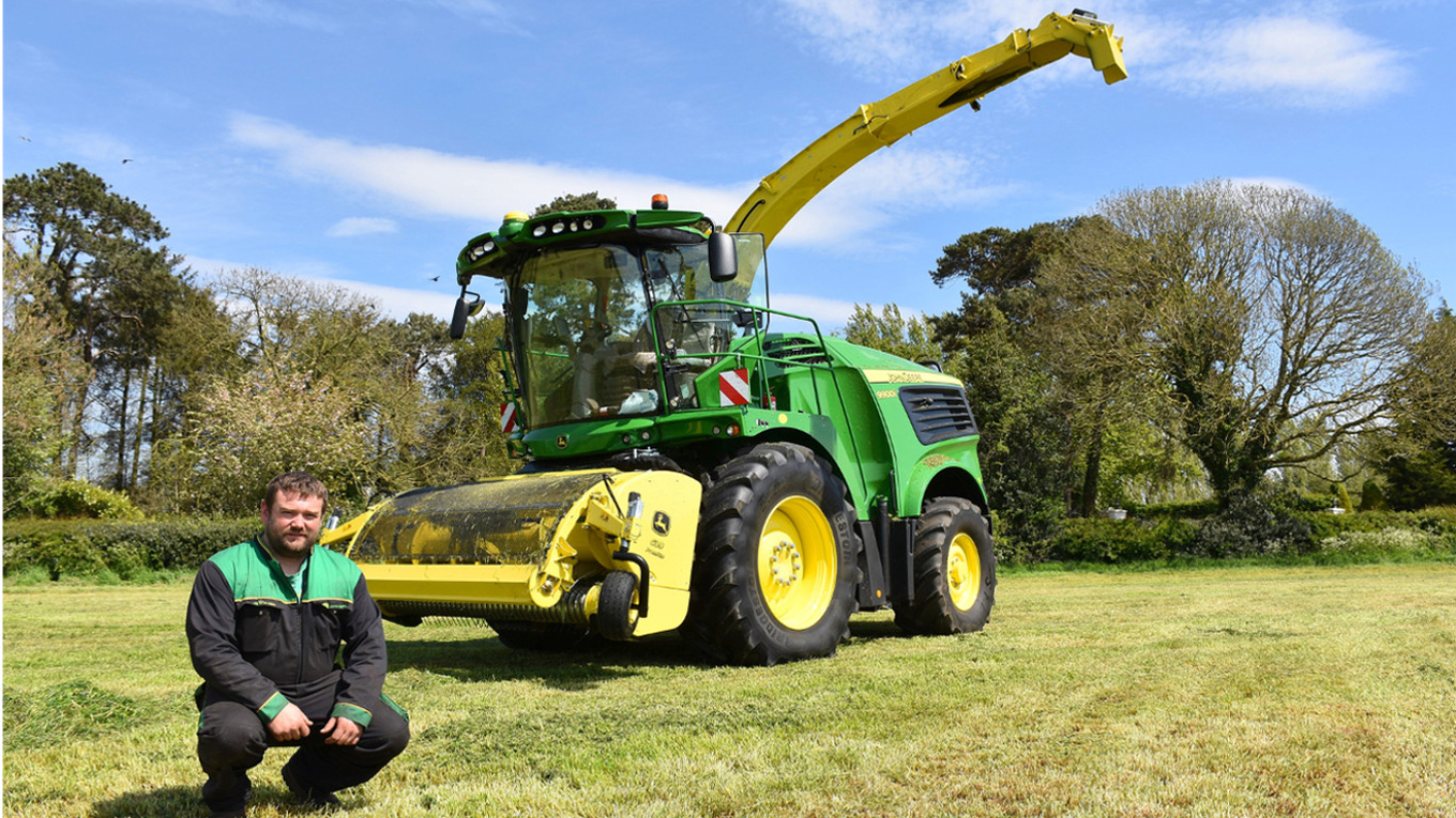 Contractor Michael Lagan with his new 9900i self-propelled forage harvester, cutting 700 acres of grass in May for a biogas plant customer.